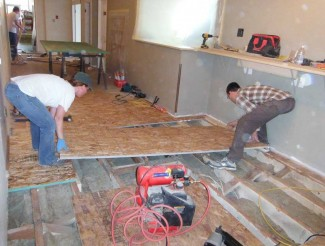 Sean and Jenn busy laying the subfloor.
