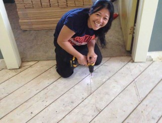 Jenn V hard at work securing the subfloor.