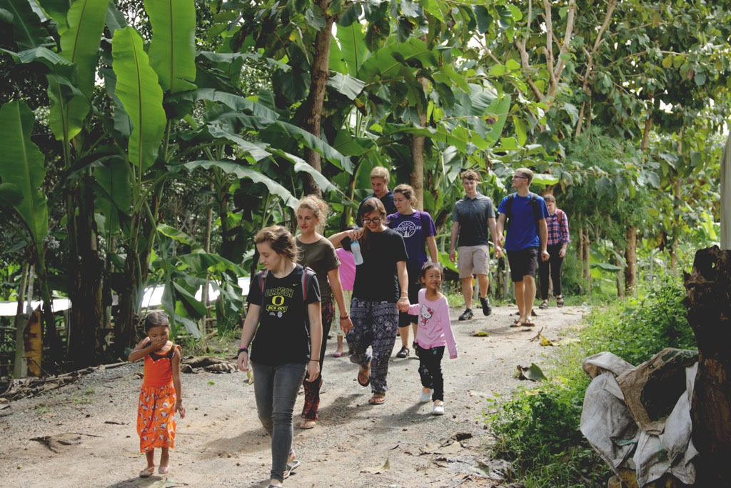 Walking back from ministry at a rubber farm.
