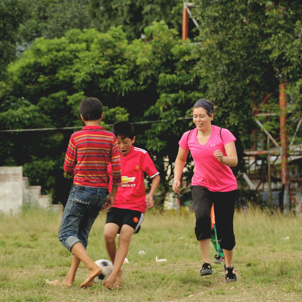 Joining a local game of soccer - YWAM Turner Valley